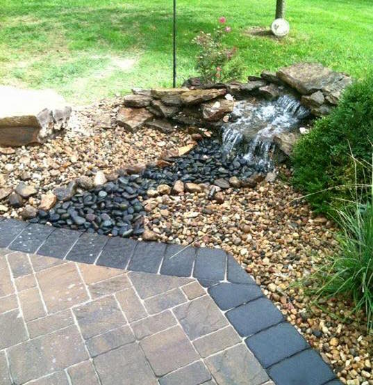 Specialty flagstone and contrasted river rock waterfall