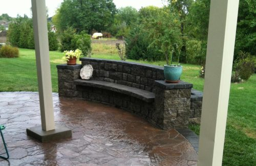 Natural stone, freestanding accent wall with raised flower bed and bench