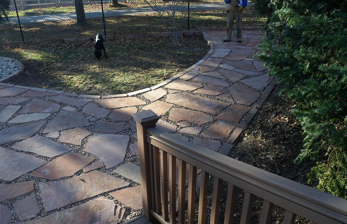 Curved flagstone walkway with pea gravel