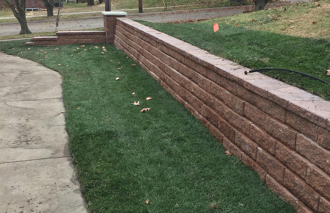 Stone retaining wall along property line