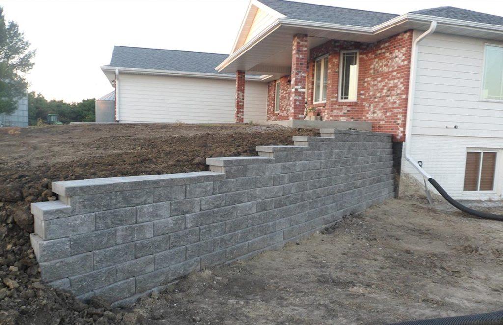 Grey, natural stone retaining wall