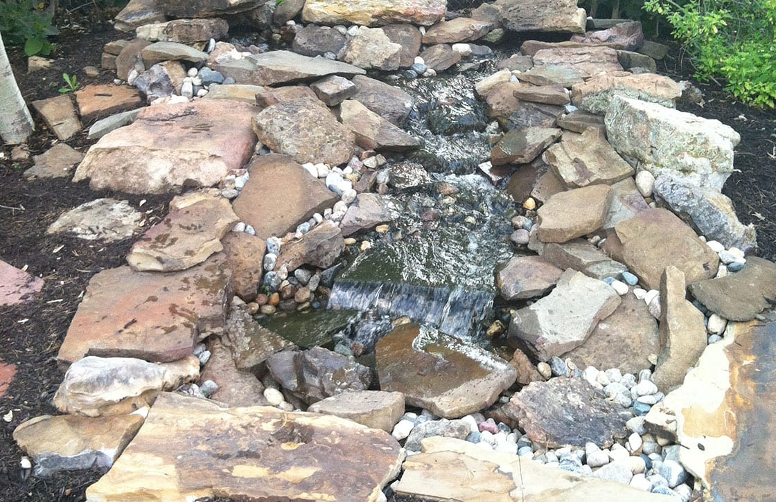 Specialty flagstone and river rock waterfall