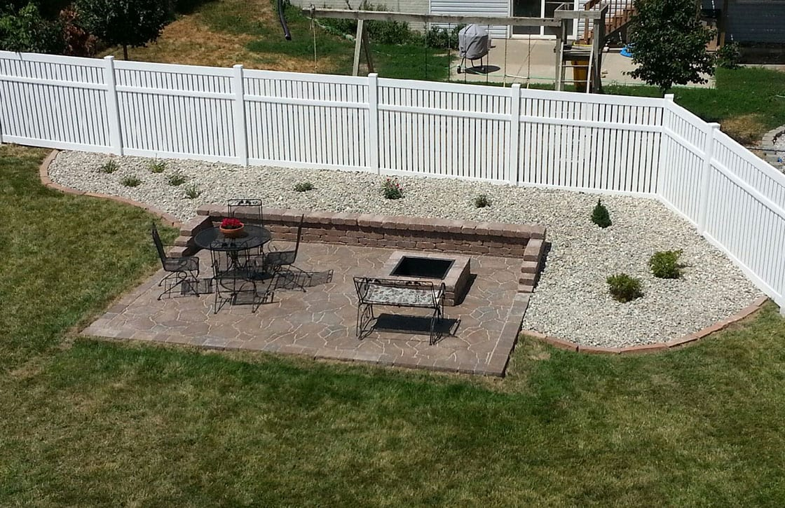 Beautiful, detached custom flagstone patio with raised square fire pit