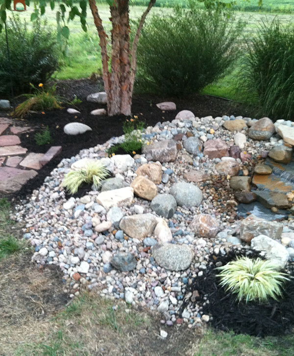 Specialty, custom designed flagstone and rock backyard waterfall