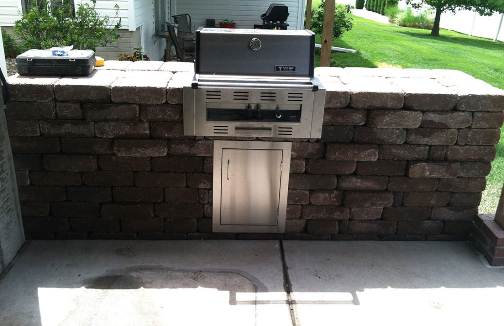 Specialty, custom built stone block grilling station