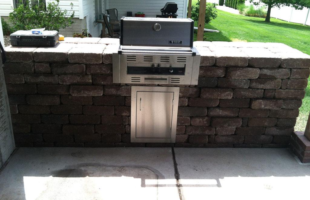 Specialty, custom built stone block grilling station