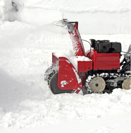 small snow blower blowing snow